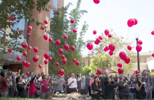 Taking flight · People gathered together for Mary Francis's service released red ballons into the air to symbolize letting go of grief. - Mariya Dondonyan | Daily Trojan