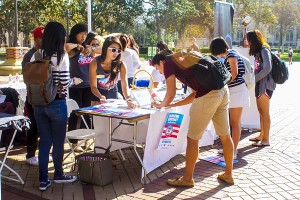 Rock the vote · Students celebrate National Voter Registration Day by registering to vote in Hahn Plaza. The event was           co-hosted by the Jesse M. Unruh Institute of Politics, USC College Democrats, USC College Republicans and others. — Liliana-Scarlet Sedano | Daily Trojan