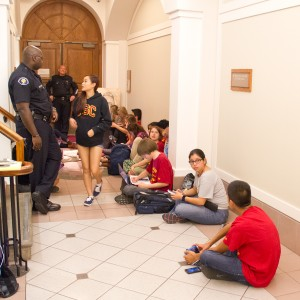 Sit in · Eighteen students from the Student Coalition Against Labor Exploitation wait outside President C. L. Max Nikias' office in Bovard Auditorium to negotiate ending business relations with JanSport. — Daily Trojan File Photo