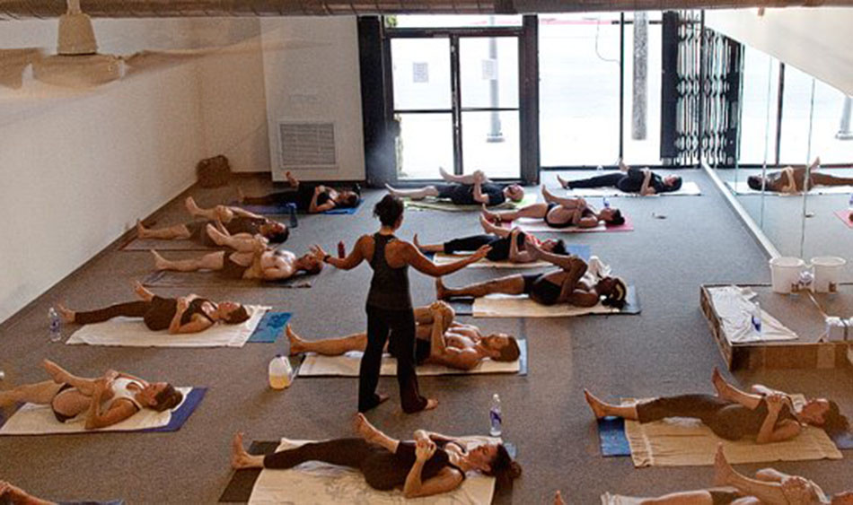At Bikram Yoga Students Exercise In 104 Degree Conditions