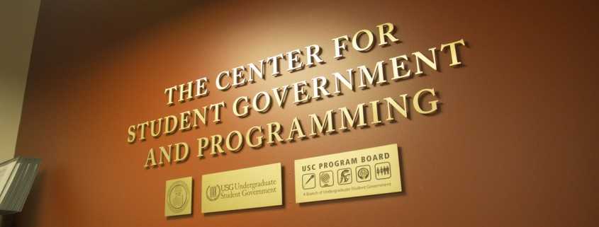 """Against a brown wall are the words """"The Center for Student Government and Programming."""""""