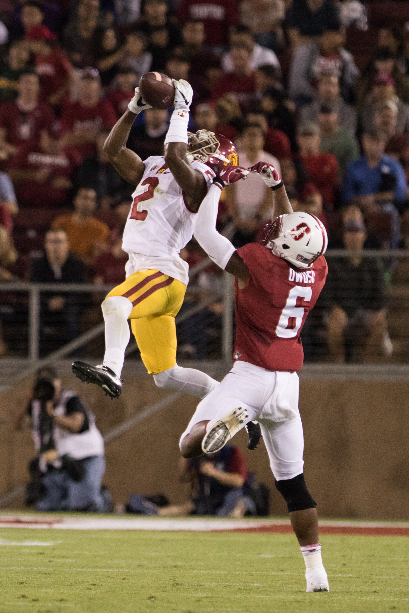 Nick Entin | Daily Trojan Adoree' Jackson leaps to intercept a pass intended for Stanford's Francis Owusu.
