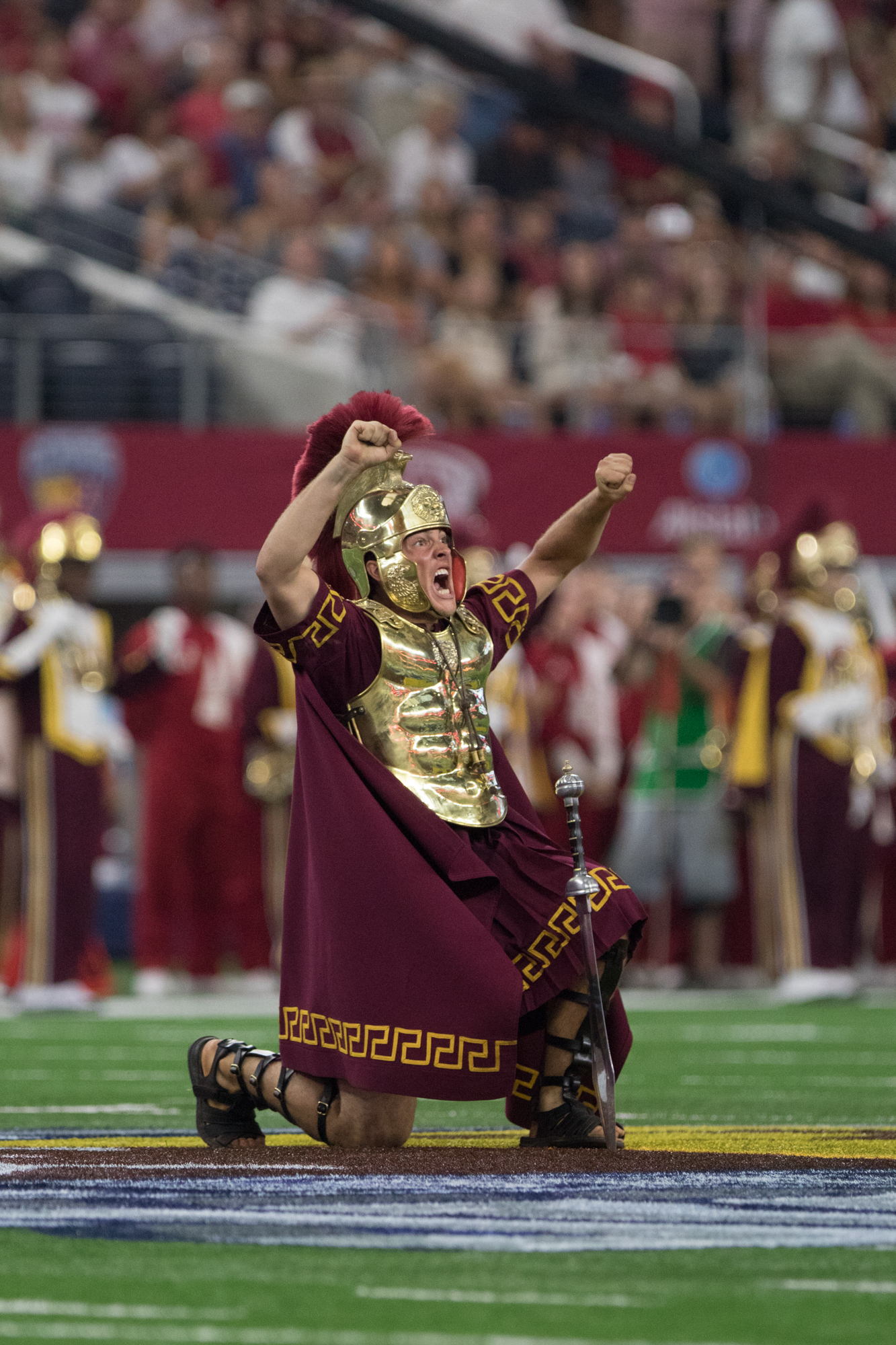 The Spirit of Troy Marching Band was led onto the field before the game by the drum major who started things off in his usual fashion — a sword in the ground.