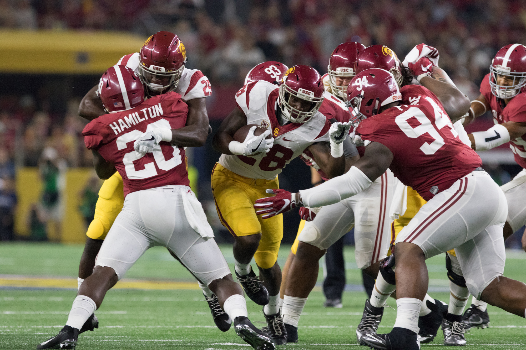 Sophomore tailback Aca'Cedric Ware gets wrapped up by the Alabama defense. Ware earned 22 yards on six carries.