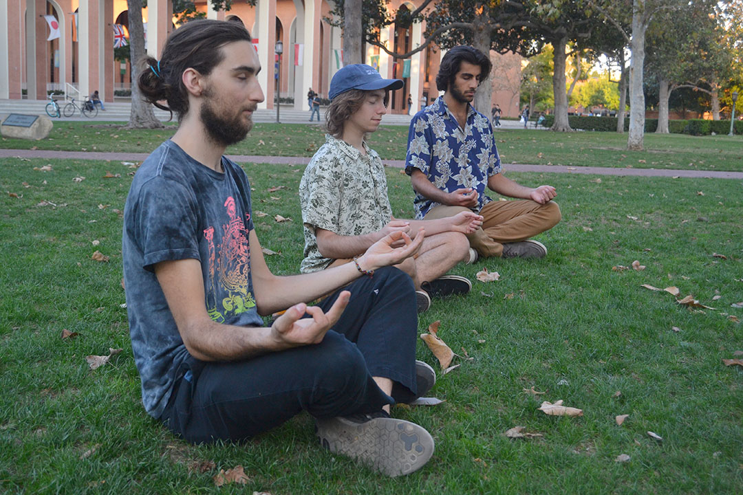 Lena Altaffer | Daily Trojan Peace out · Students engage in quiet meditation at Wednesday's event, which aimed to connect individual peace with world peace.