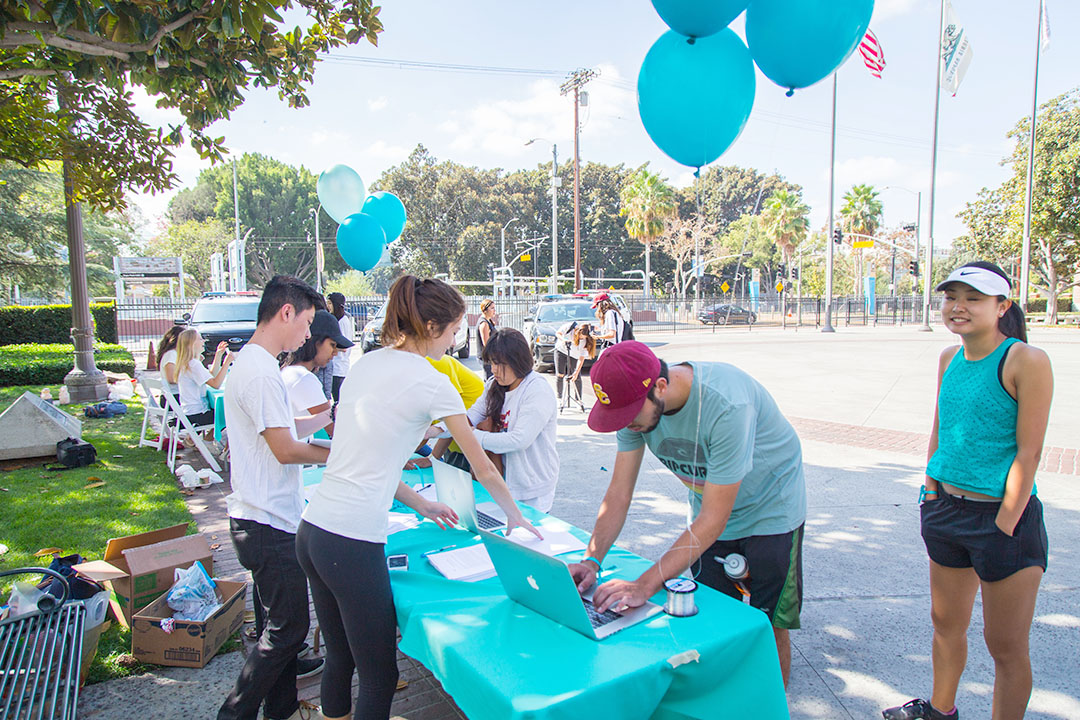 Photo courtesy of Daniel Zhu Ready, set, inspire · Participants lined up to register for the It Ends Here run/walk that took place at Pardee Plaza on Sunday morning.