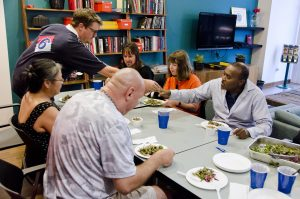 Photo courtesy of Jack Lahey A helping hand · Jack Lahey, a USC alumnus, co-created Nourished to help the formerly homeless build lasting relationships with USC students through the shared experiences of cooking healthy food and eating it together.