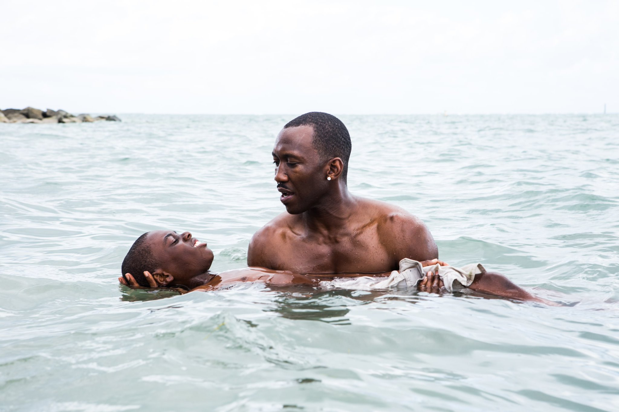 Photo from A24 Three phases · Told in three chapters, Moonlight tells the story of a black man struggling with his sexuality and identity while growing up in Miami. The film has been unanimously acclaimed by critics since its premiere.