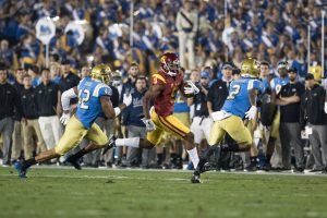 Junior wide receiver JuJu Smith-Schuster catches a pass against UCLA. He dealt with an apparent hip injury all game long - Nick Entin | Daily Trojan
