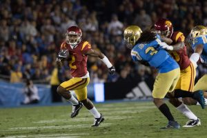 Adoree' Jackson runs for a gain on offense in USC's win over UCLA - Nick Entin | Daily Trojan