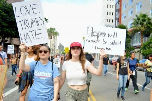 Emily Smith | Daily Trojan Civil unrest · Protestors hold up signs at an anti-Donald Trump rally that attracted thousands to downtown Los Angeles on Saturday morning. This was the largest gathering to take place in L.A. since the election results. Nov. 8.