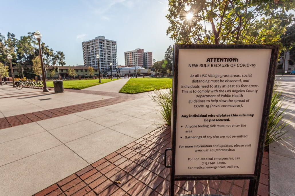 Signs posted across campus and at USC Village outlines Los Angeles County public health practices all visitors must comply with. The rules listed include not entering the area if sick, and a complete prohibition on gatherings.