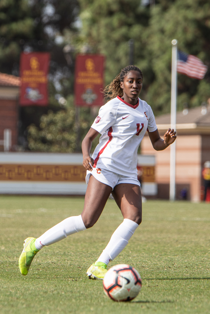 """Midfielder Olufolasade """"Sade"""" Adamolekun plays a pass in a conference game against Washington on Oct 27, 2019."""