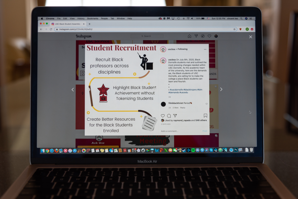 A post on the Black Student Assembly's Instagram account detailing the demands of Black students to the Dornsife College of Letters, Arts and Sciences. The demand featured calls for the recruitment of Black professors, for the school to highlight Black students achievements and the creation of better resources for enrolled Black students. The post is displayed on a MacBook Air with other posts detailing demands to other schools and to USC in the background.