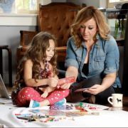 Jennifer with her daughter Charlotte playing a boardgames