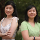 Jade Lee standing to the left with Jaclyn Dong to the right and both their arms folded