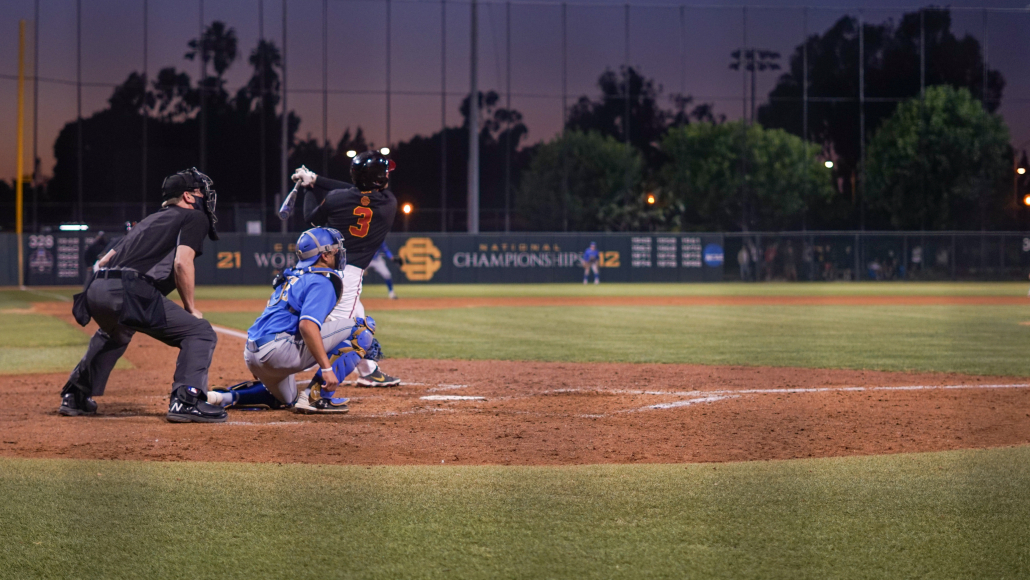 Jamal O'Guinn watches the ball after he hits it in a game against UCLA.