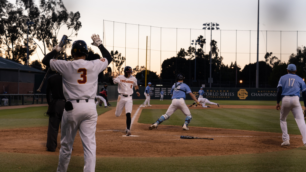 Number eight Ben Ramirez touches home plate at the bottom of the fifth against San Diego.