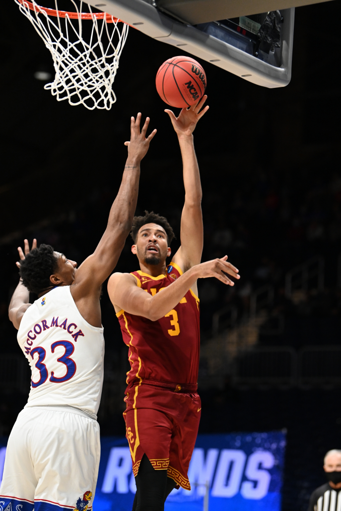 Isaiah Mobley attempts a shot while being contested by a Kansas player.