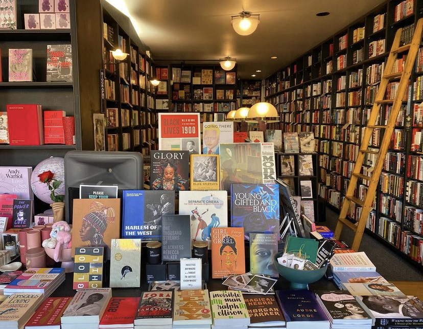 A photo of a specific book display inside the Book Soup store, with novels and knickknacks spread across a table.