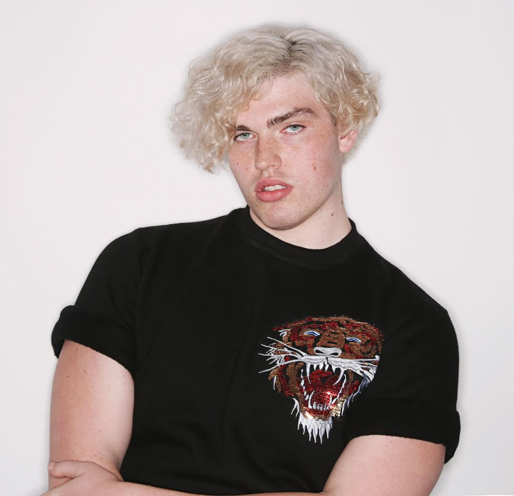 A photo of Andrew Rudy against a white background wearing a black t shirt.