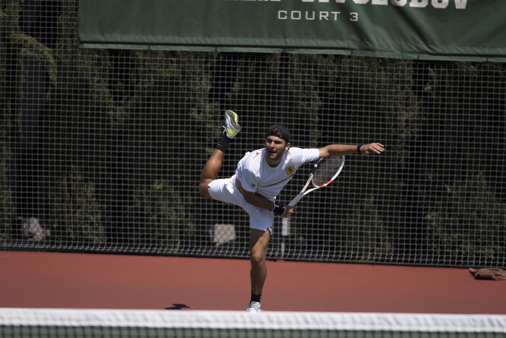 Sophomore Stefan Dostanic following through on a serve