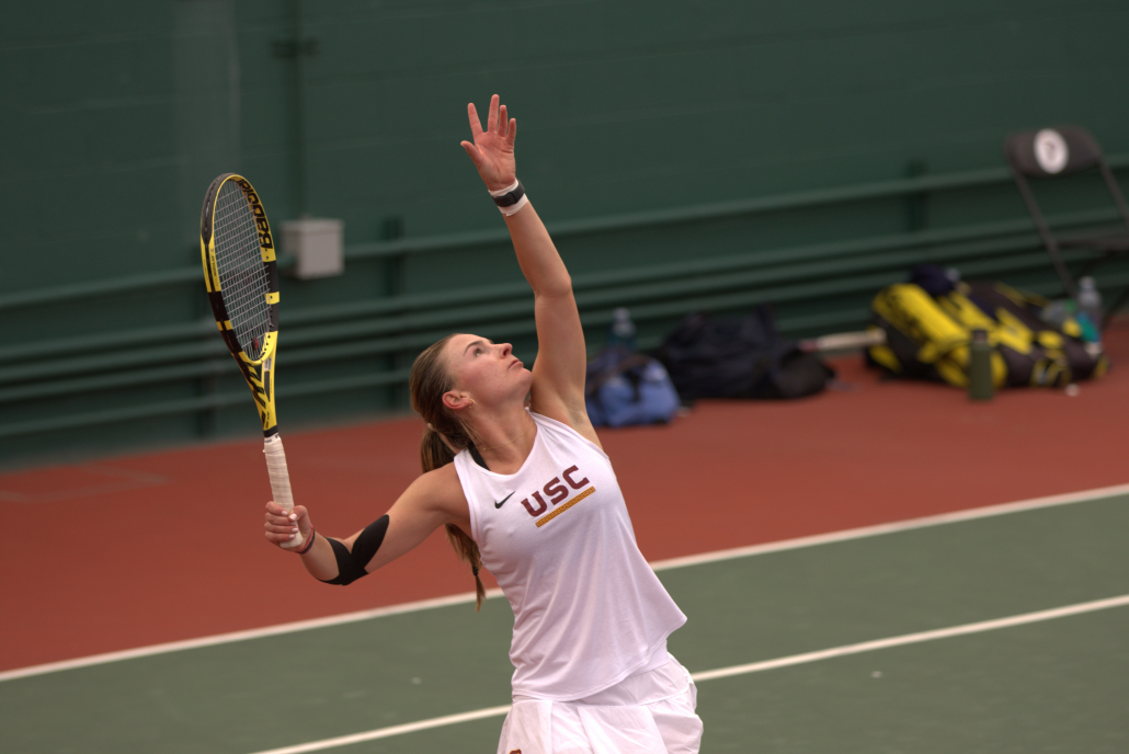 Summer Dvorak waiting for the ball to come down while serving in a match.