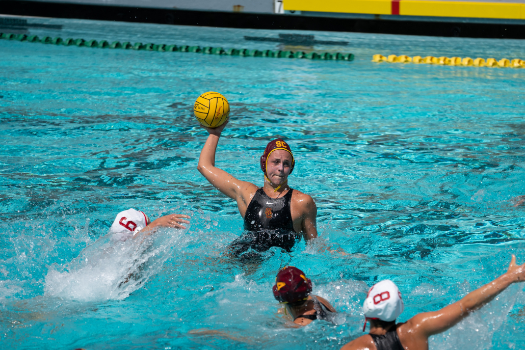 Denise Mammolito throws above a couple of defenders in the water
