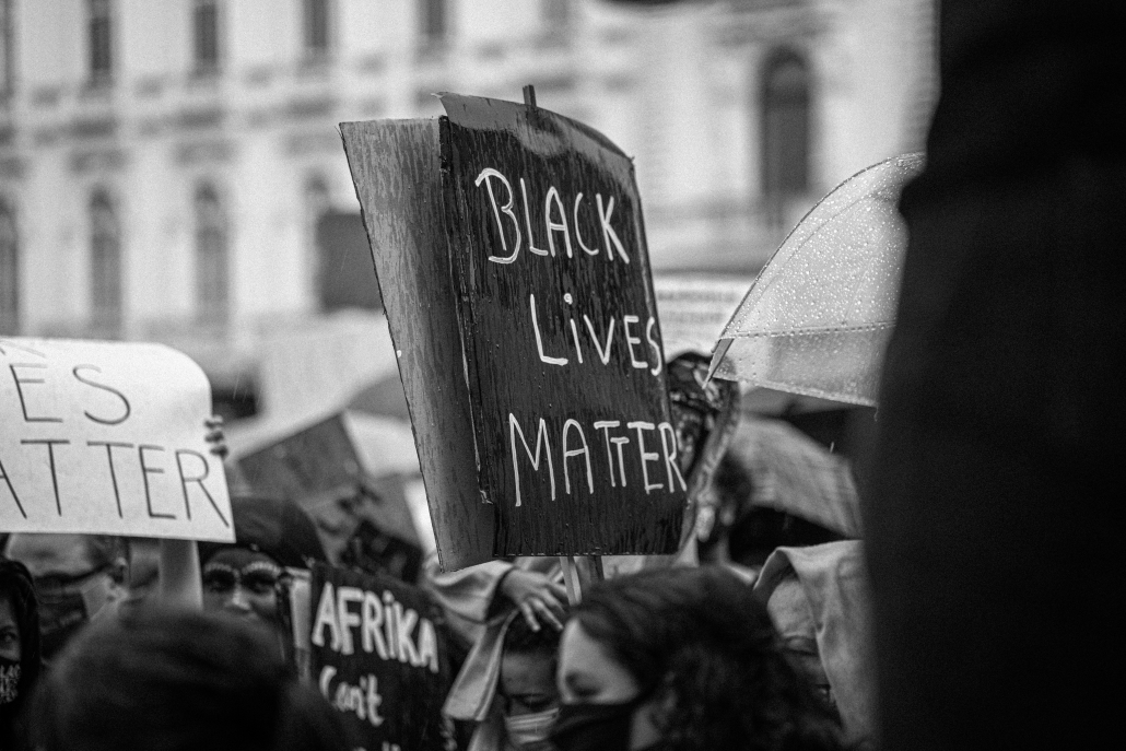 """Crowd of people, sign that is held up reads """"Black Lives Matter."""""""