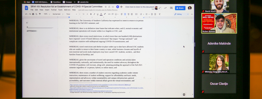 A laptop screen with the zoom meeting