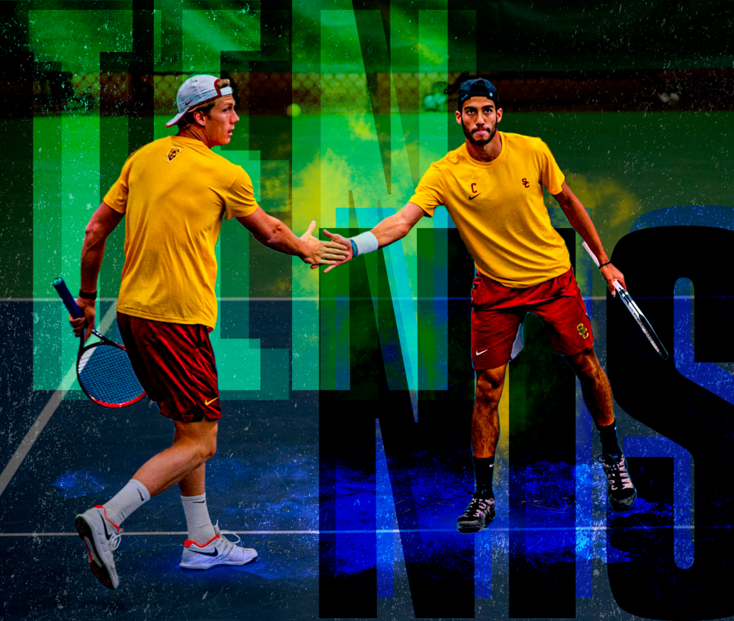 Holding their rackets, men's tennis duo Daniel Cukierman and Riley Smith high five after a point during a tennis match. In the background, the word tennis is displayed in large, bold font behind the players.