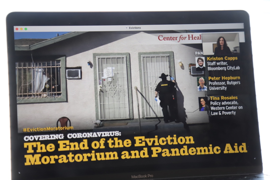 """Photo of a computer screen with a panelist speaking. The text reads """"Covering coronavirus: The End of the Eviction Moratorium and Pandemic Aid."""""""