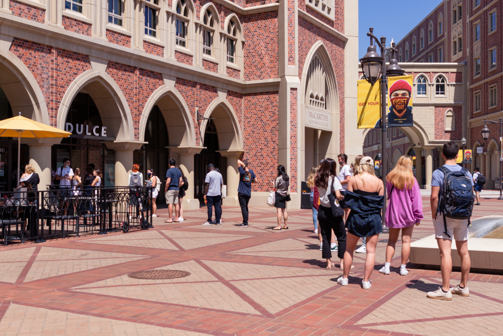 Students wait in a line to enter Dulce in the USC Village.