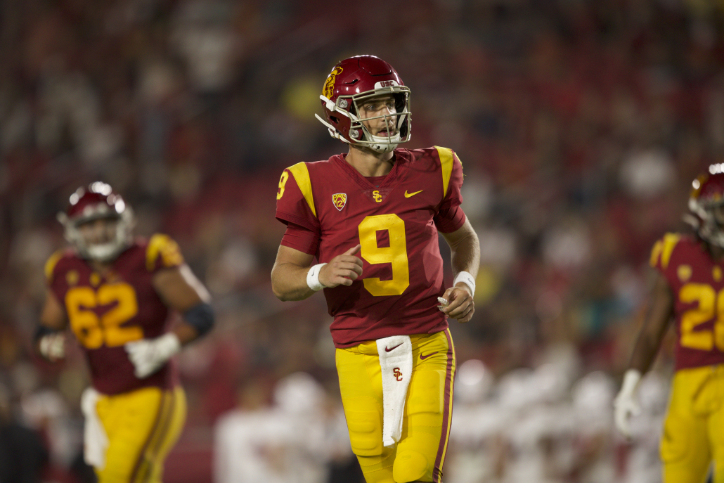USC junior quarterback Kedon Slovis jogs off the field looking toward his left side.