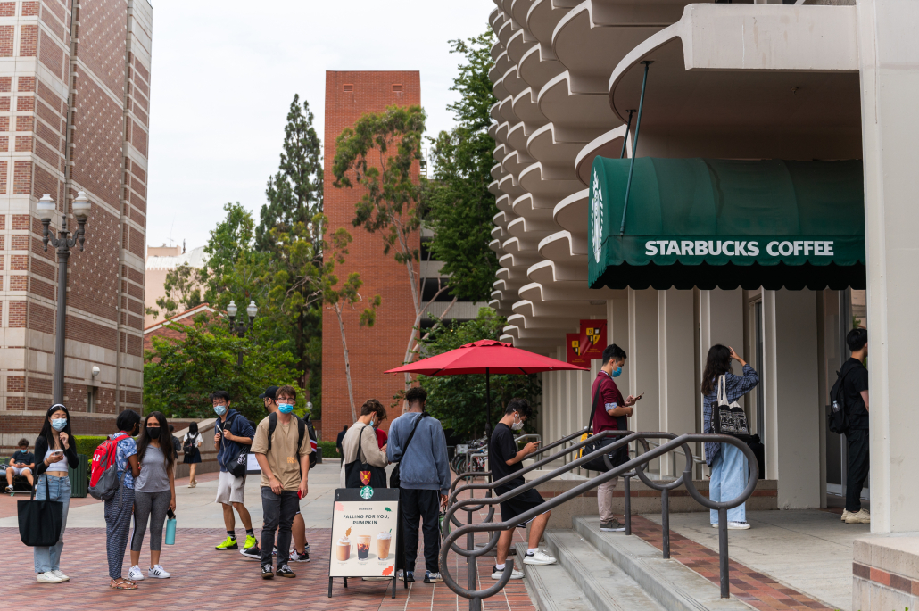 Students wait in a line outside of the Starbucks at Trojan Grounds.