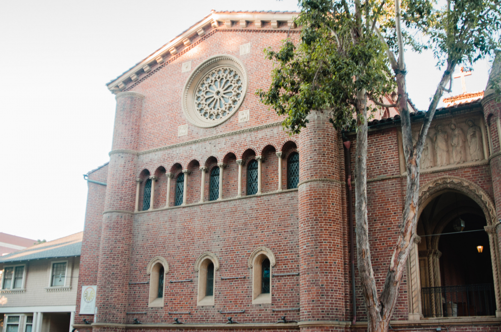 A picture of the United University Church building, which is made out of red brick and features stain glass windows.