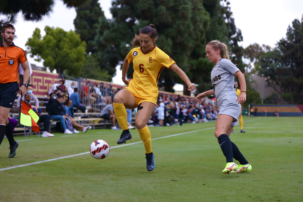 Sophomore forward Katie Roditis shields the ball from a defender.