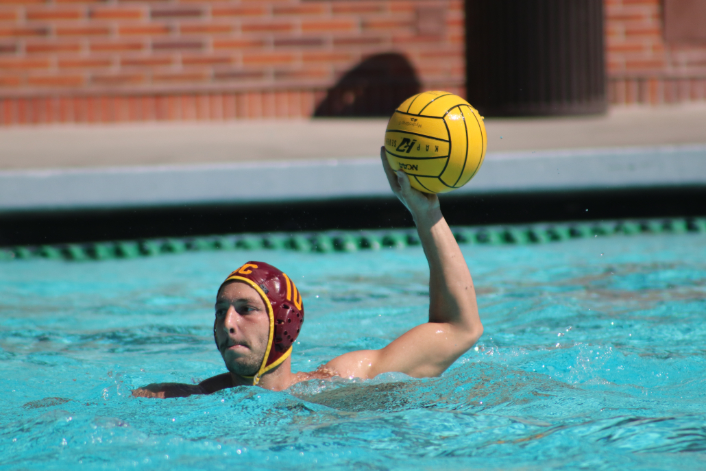 Junior driver Marcus Longton holds the ball, looking to distribute in Saturday'sgame against UC Berkeley.