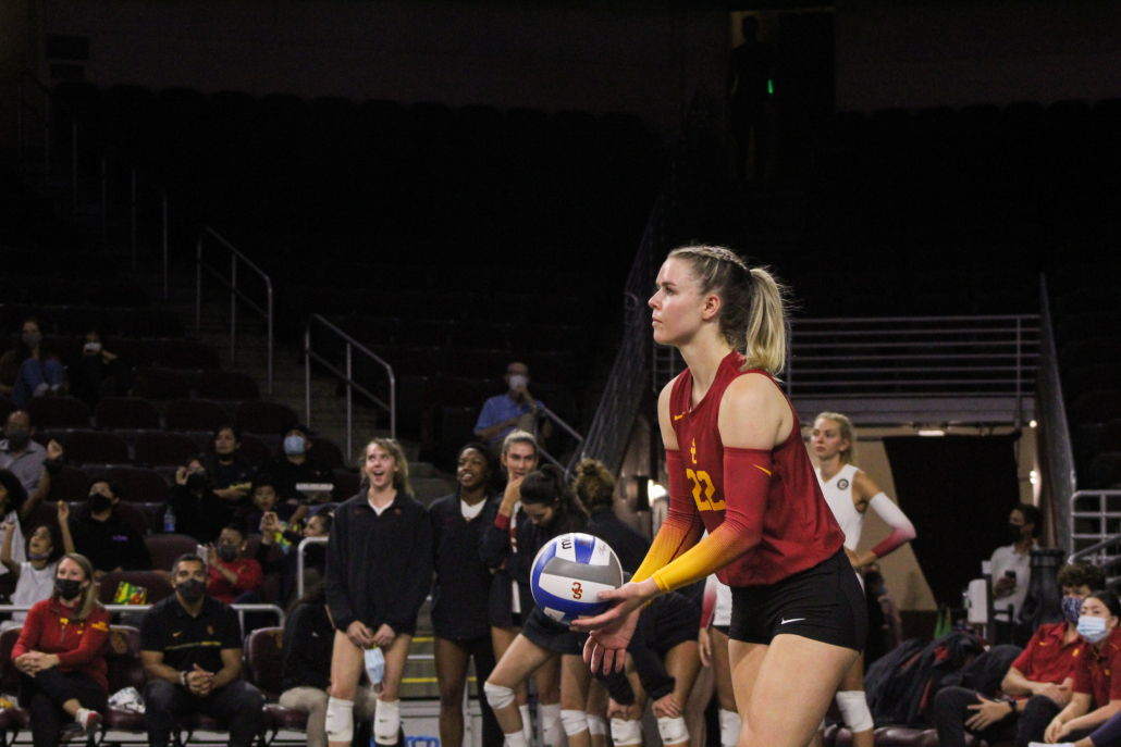 Graduate student outside hitter Shannon Scully prepares to serve.