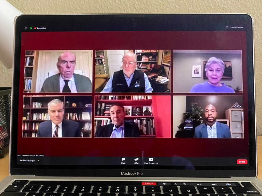 Computer screen open to a Zoom event, featuring experts speaking on voting rights and wrongs.