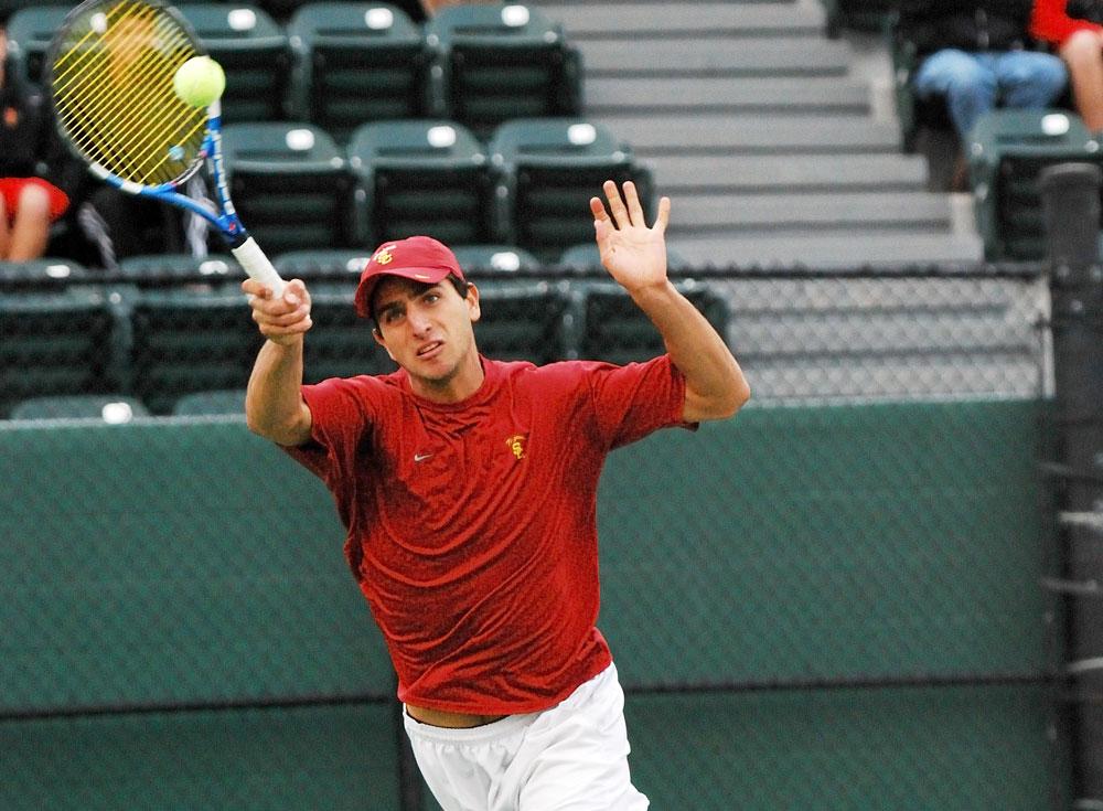 USC tennis athlete Robert Farah attempts a drop shot in a match.