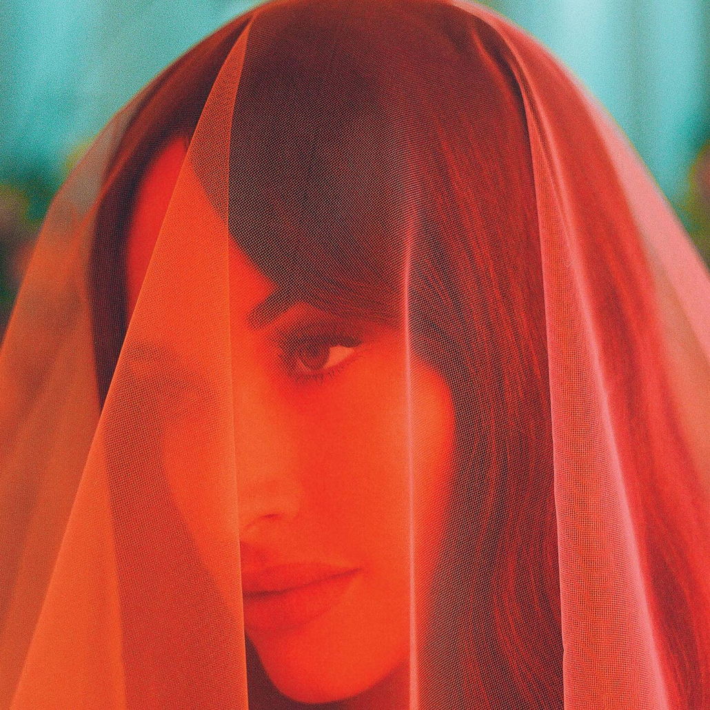 Musgraves wears a pink veil on her album cover.